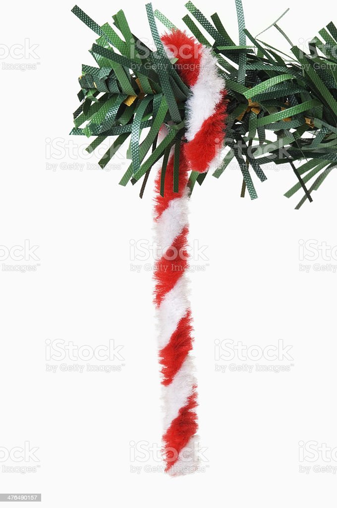 Close-up of a cane hanging on a Christmas tree royalty-free stock photo