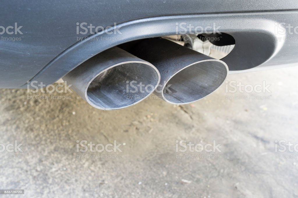 Closeup of a car exhaust. stock photo