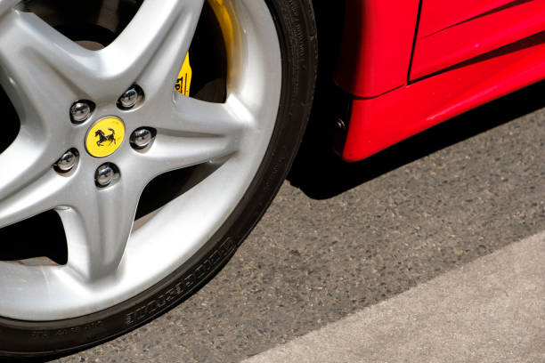 Closeup of a car tire with ferrari logo design brand name at oldtimer picture id987451200?b=1&k=6&m=987451200&s=612x612&w=0&h=prhnrha6zulnne6fjekw wj9ushp6hwrom8wa2hggye=