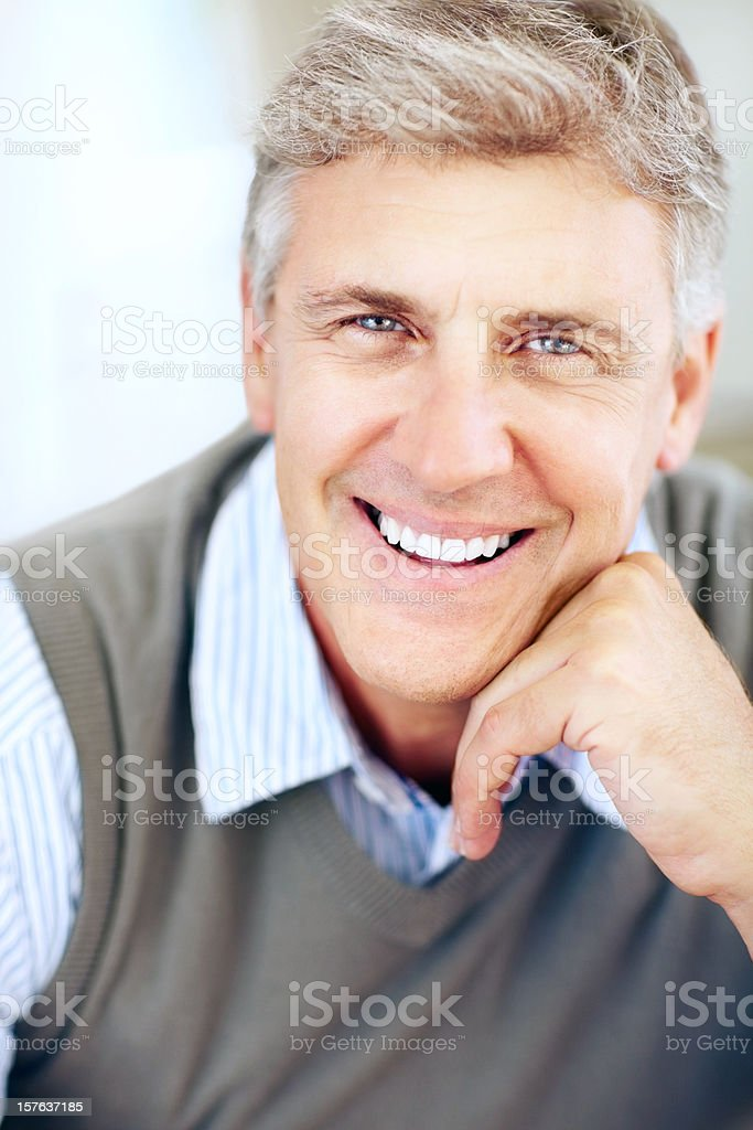 Close-up of a casual mature man with hand on chin royalty-free stock photo