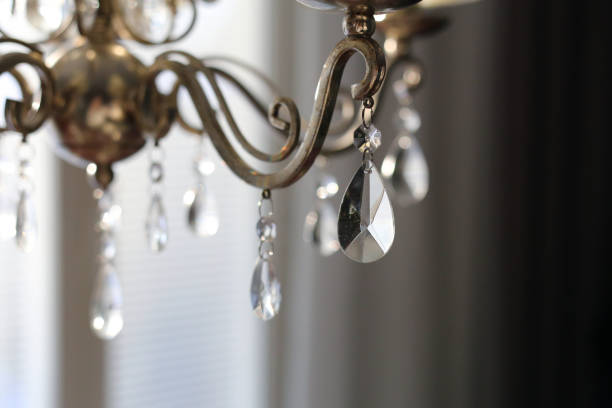 A closeup of a chandelier made of bronze and crystals stock photo