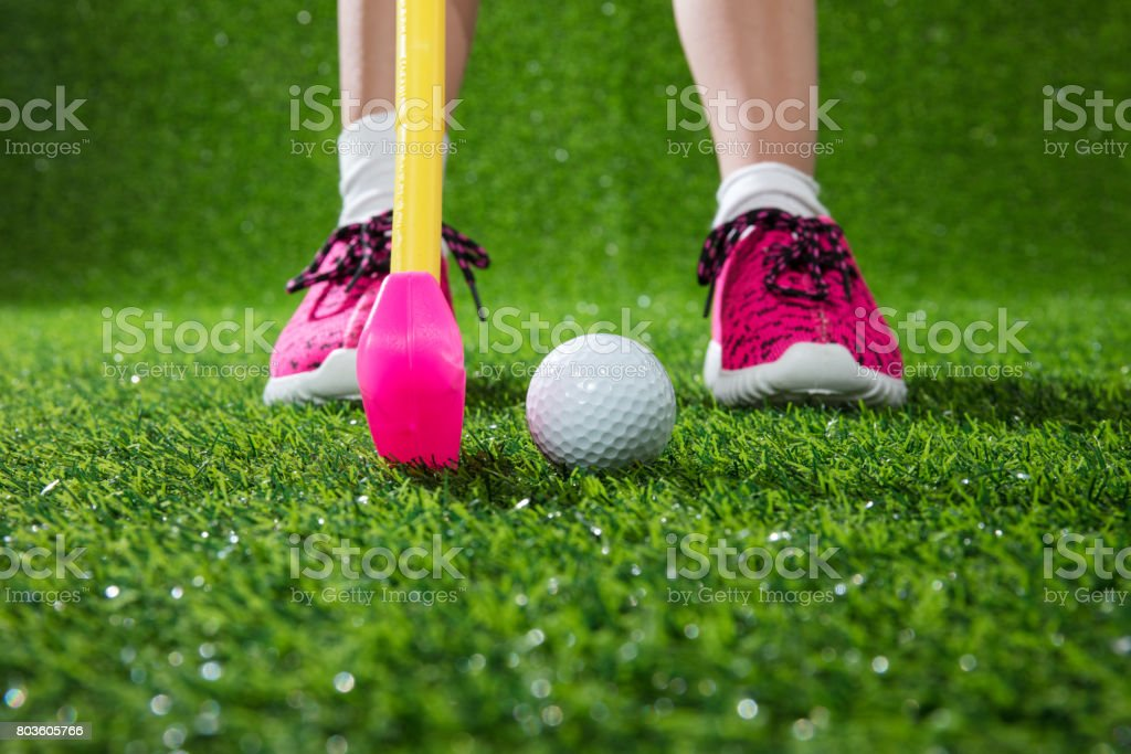 Closeup of a child golfer with putter and ball stock photo