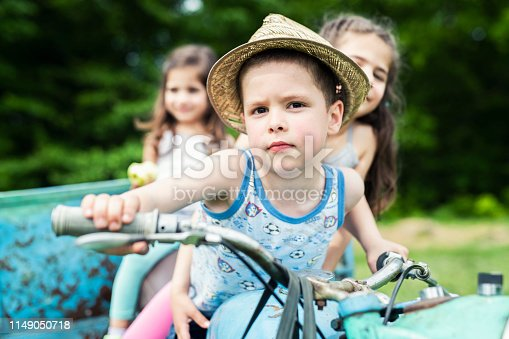 Close-up of a children sitting on a motorcycle, vintage motorcycle, playing on motorbike.