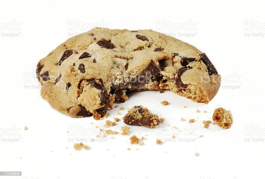 Close-up of a chocolate chip cookie with a bite stock photo