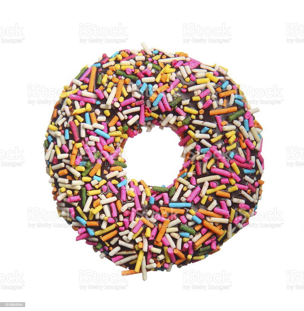 Close-up of a chocolate donut with multicolored sprinkles stock photo