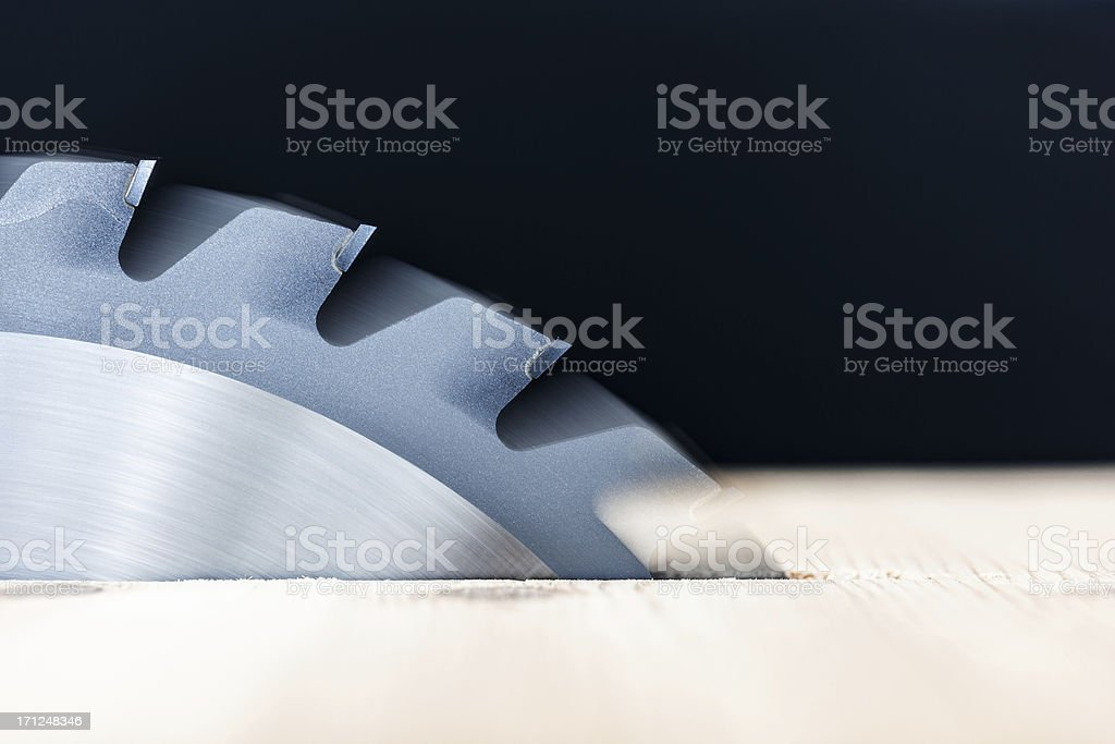 Close-up of a circular saw blade with blurred motion stock photo