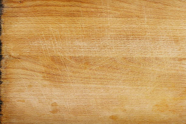 Close-up of a clean but used wooden cutting board surface