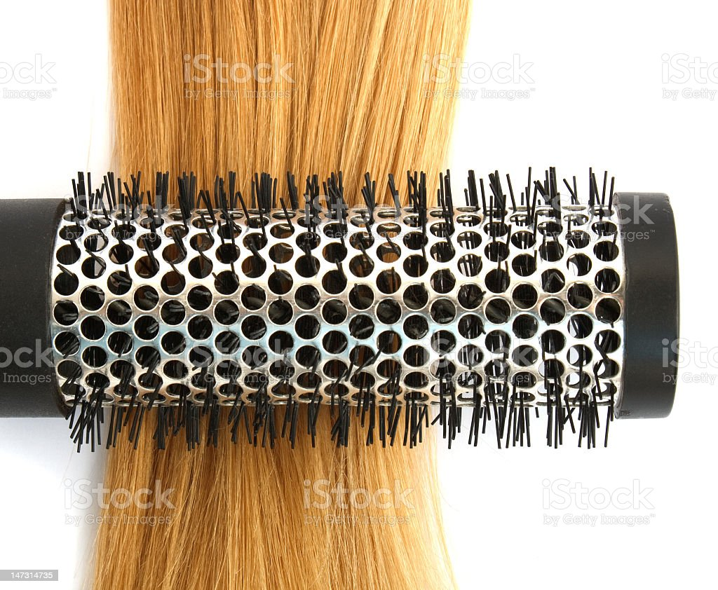 Close-up of a comb in a blond piece of hair royalty-free stock photo