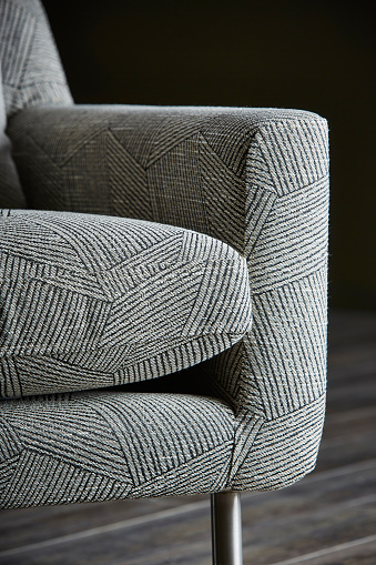 Close-up of a comfortable sofa with striped pattern fabric in living0 room