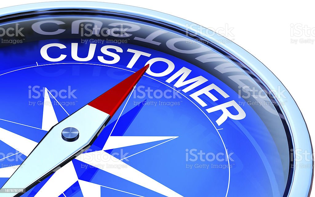 Close-up of a compass with the red pointing to customer stock photo