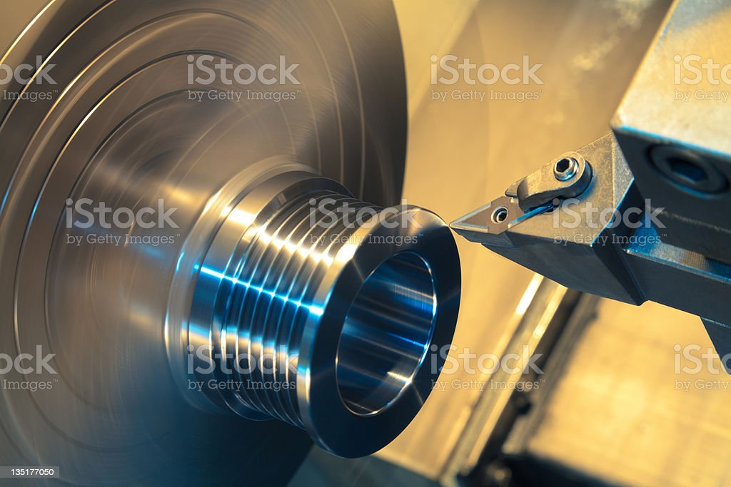 A close-up of a computer controlled machine turning stock photo