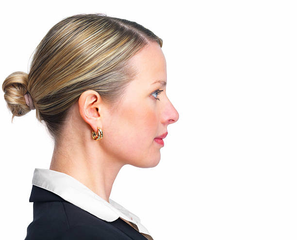 close-up of a confident young businesswoman - profile view stock photos and pictures