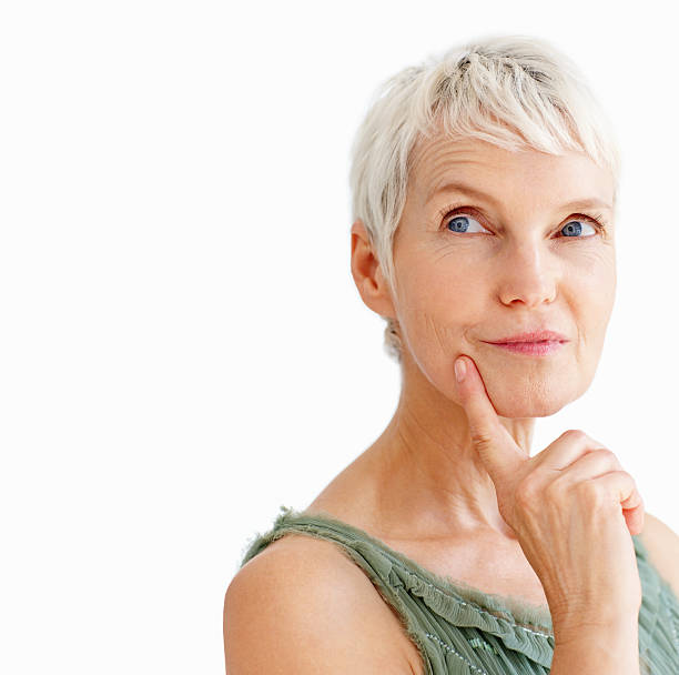 Close-up of a contemplative senior lady Close-up of a contemplative senior lady raised eyebrows stock pictures, royalty-free photos & images