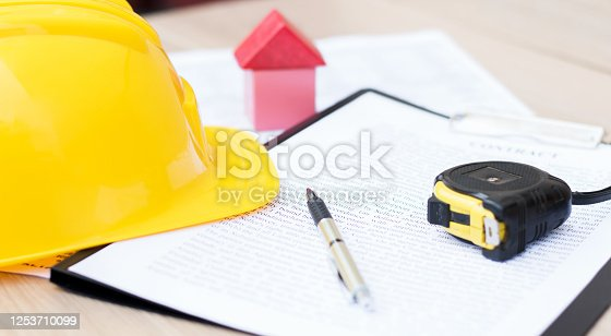 1055059750 istock photo Close-up of a contract for a construction project. Real estate, business 1253710099