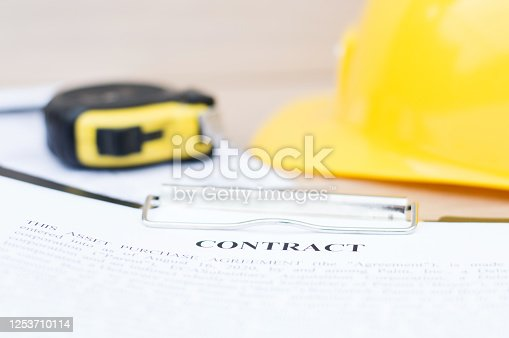 1055059750 istock photo Close-up of a contract for a construction project. Real estate, business 1253710114