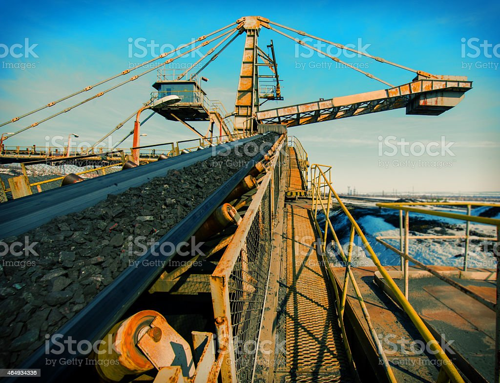 Close-up of a conveyor by the water stock photo