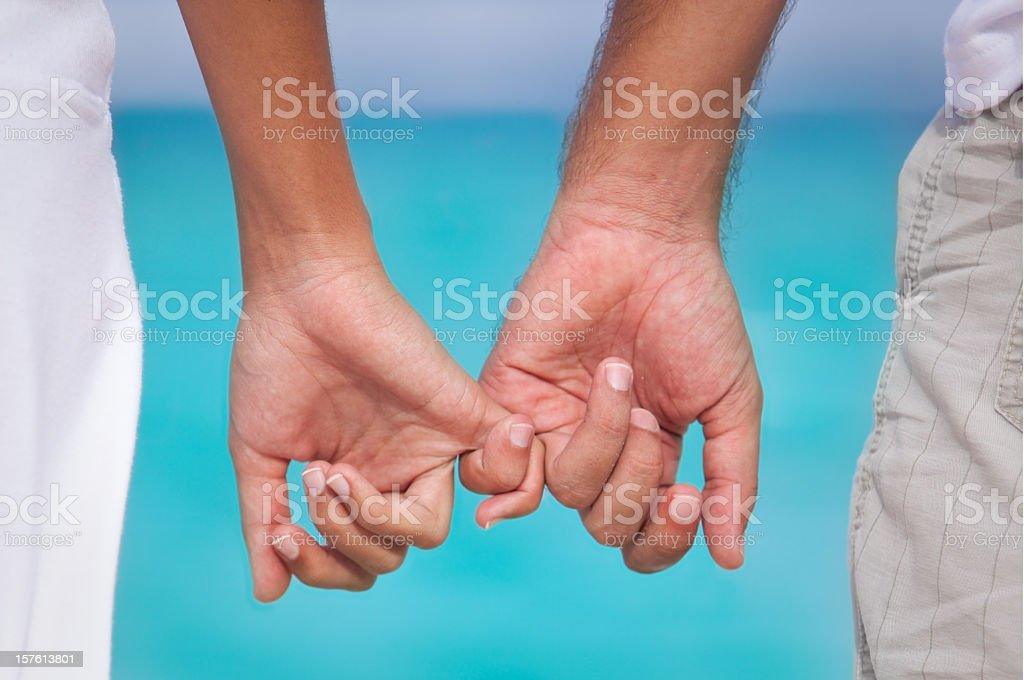 Closeup of a couple holding hands royalty-free stock photo