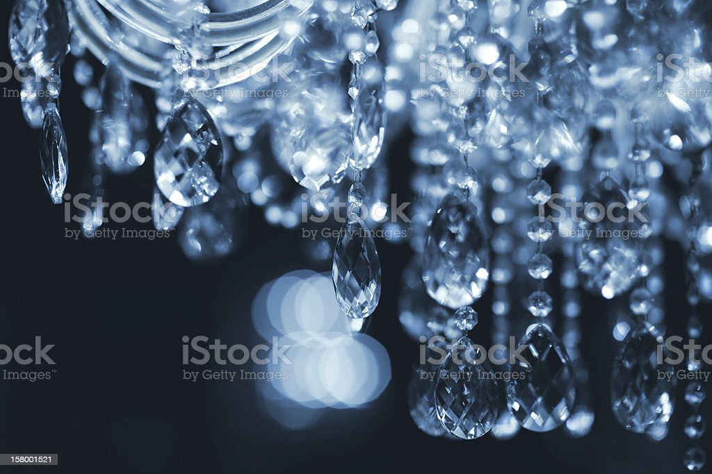 Close-up of a crystal chandelier on a black background stock photo