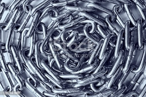 istock Close-up of a curled up metal chain 1282141937