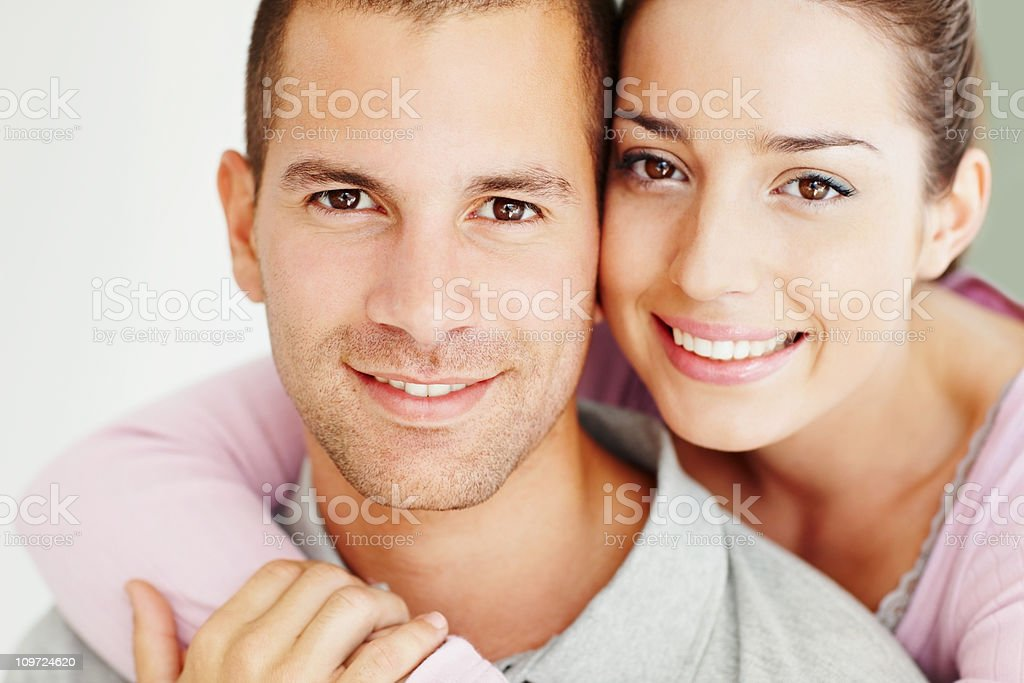 Close-up of a cute young couple smiling together stock photo