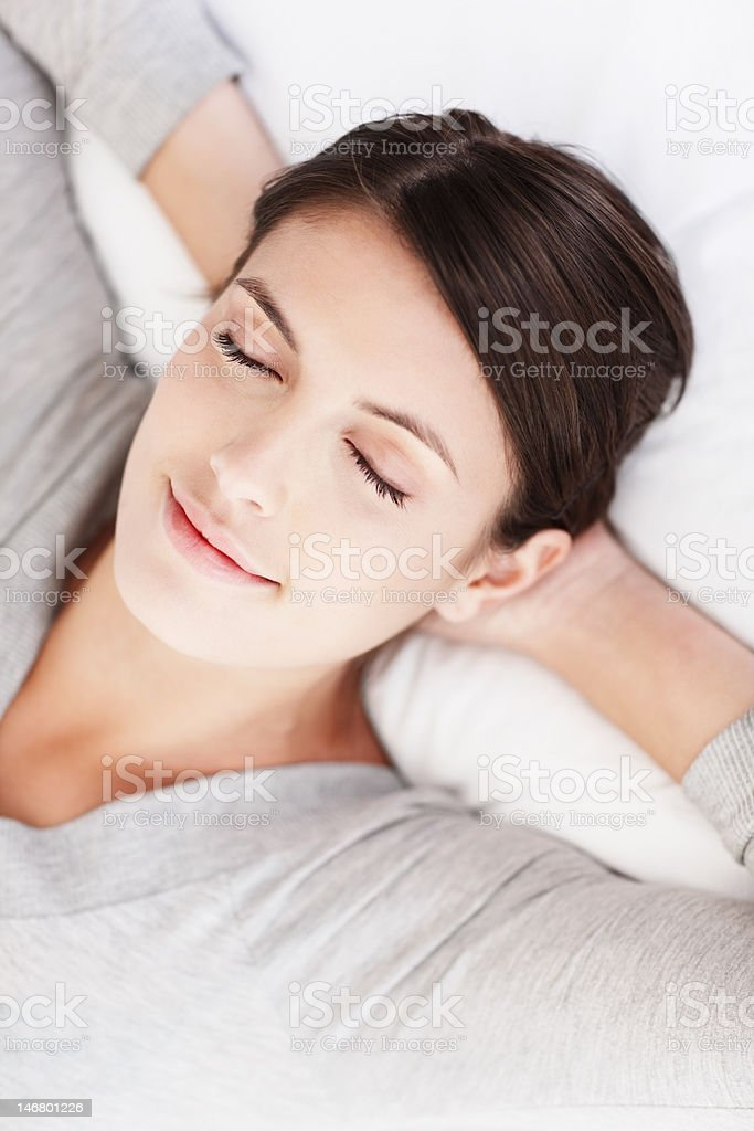 Closeup of a cute young girl sleeping on bed royalty-free stock photo