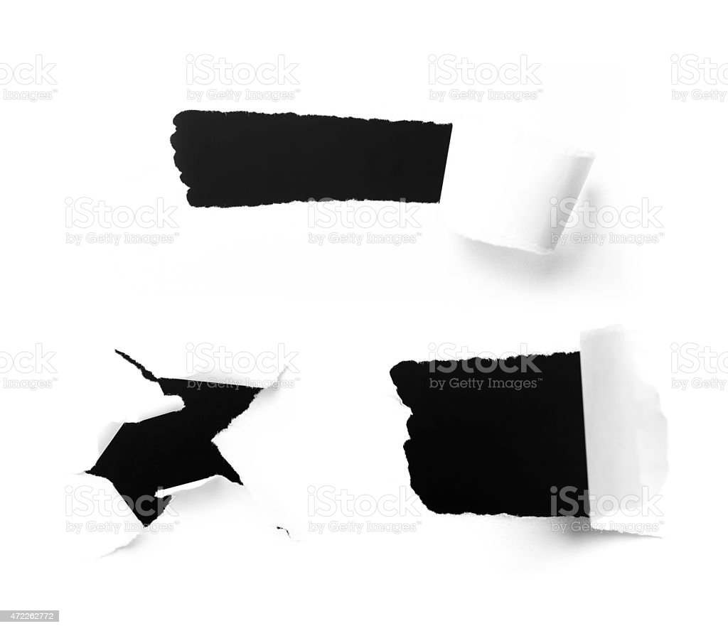 Closeup of a dark holes on white paper set stock photo