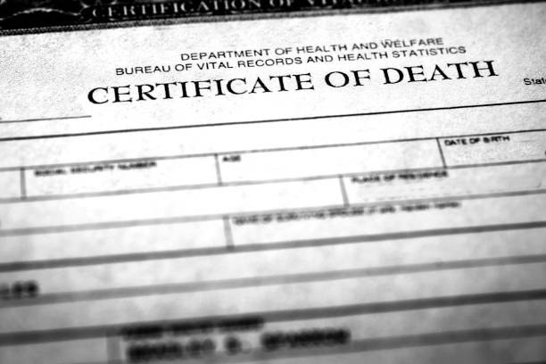 Closeup of a death certificate Closeup of a death certificate symbolizing peron who passed away dead stock pictures, royalty-free photos & images