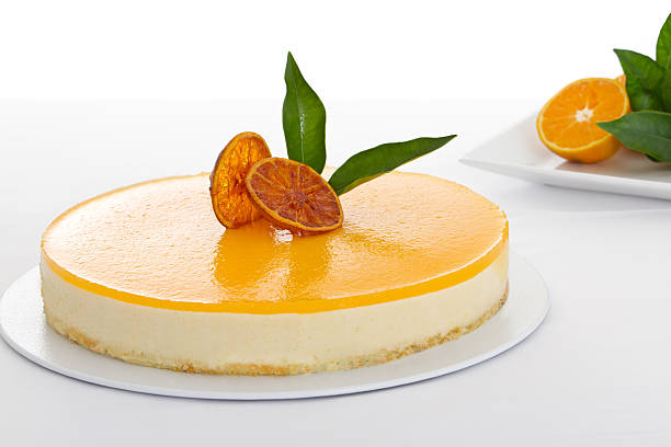 Close-up of a delicious orange cheesecake Orange cheescake gelatin stock pictures, royalty-free photos & images