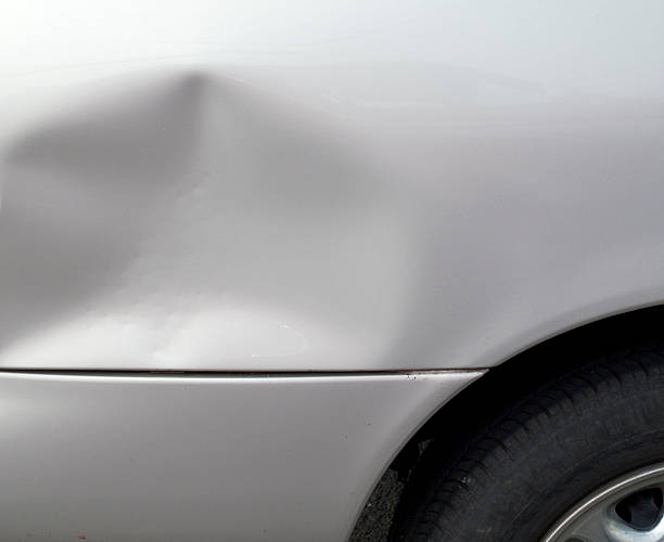 close-up of a dent in a gray car exterior - dent stock pictures, royalty-free photos & images