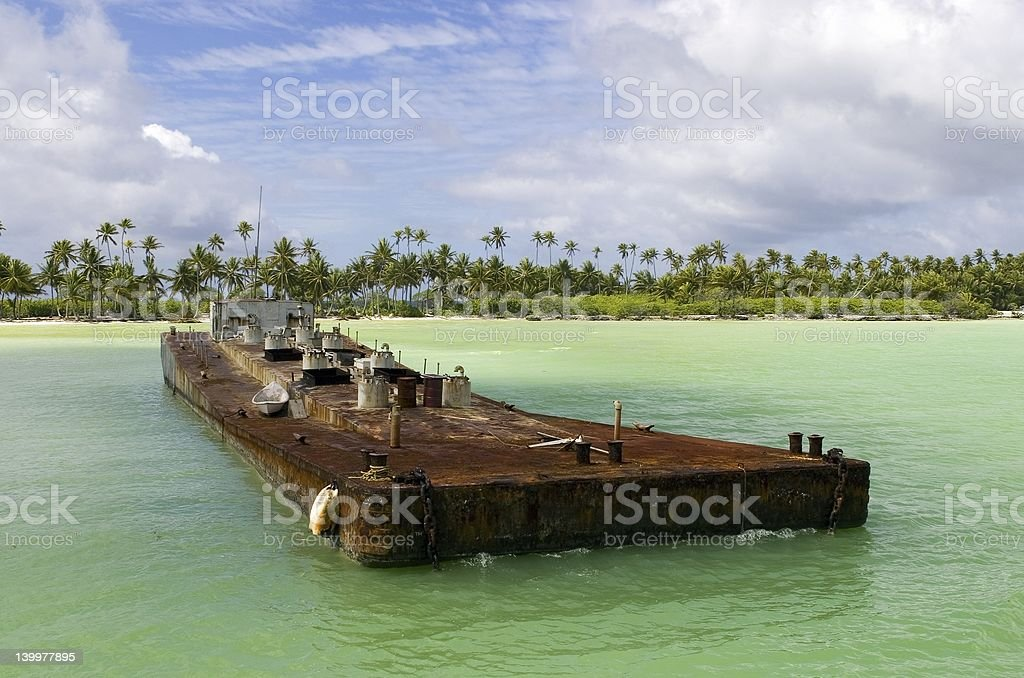 Close-up of a deserted and rusted ship near beach stock photo