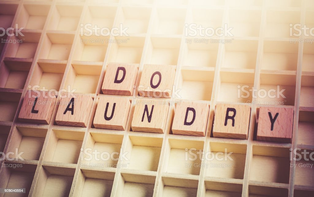 Closeup Of A Do Laundry Reminder Formed By Wooden Blocks In A Typecase stock photo