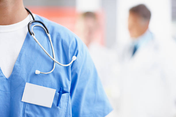 Close-up of a doctor in scrubs with stethoscope stock photo
