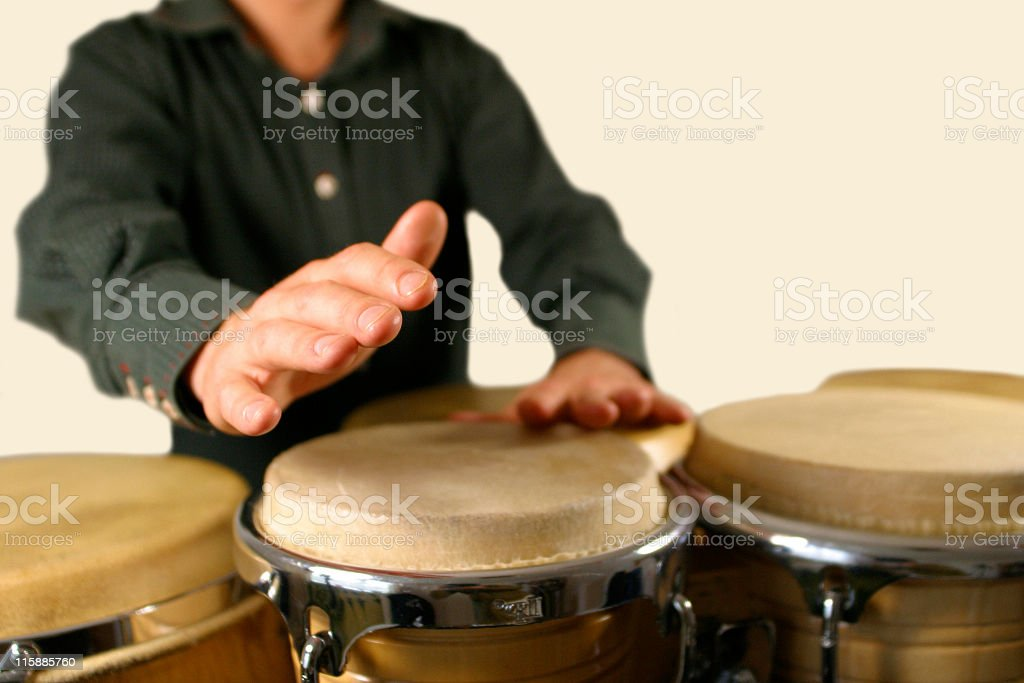 Close-up of a drummers hands playing the bongos stock photo