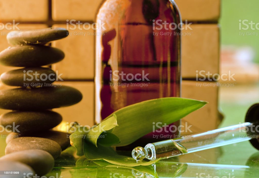 A close-up of a eye dropper and a bottle of medicine royalty-free stock photo