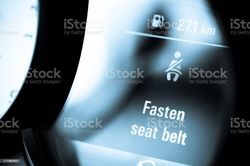 A close-up of a fasten your seatbelt sign stock photo