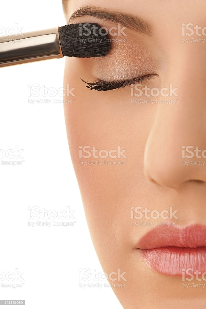 Close-up of a female applying make-up royalty-free stock photo