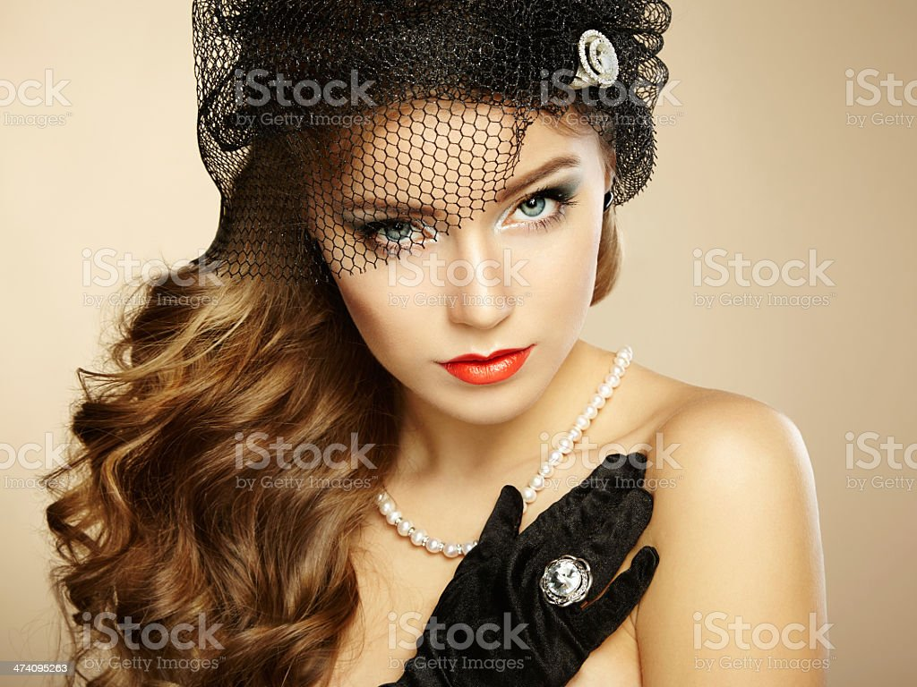A close-up of a female model in retro clothing royalty-free stock photo