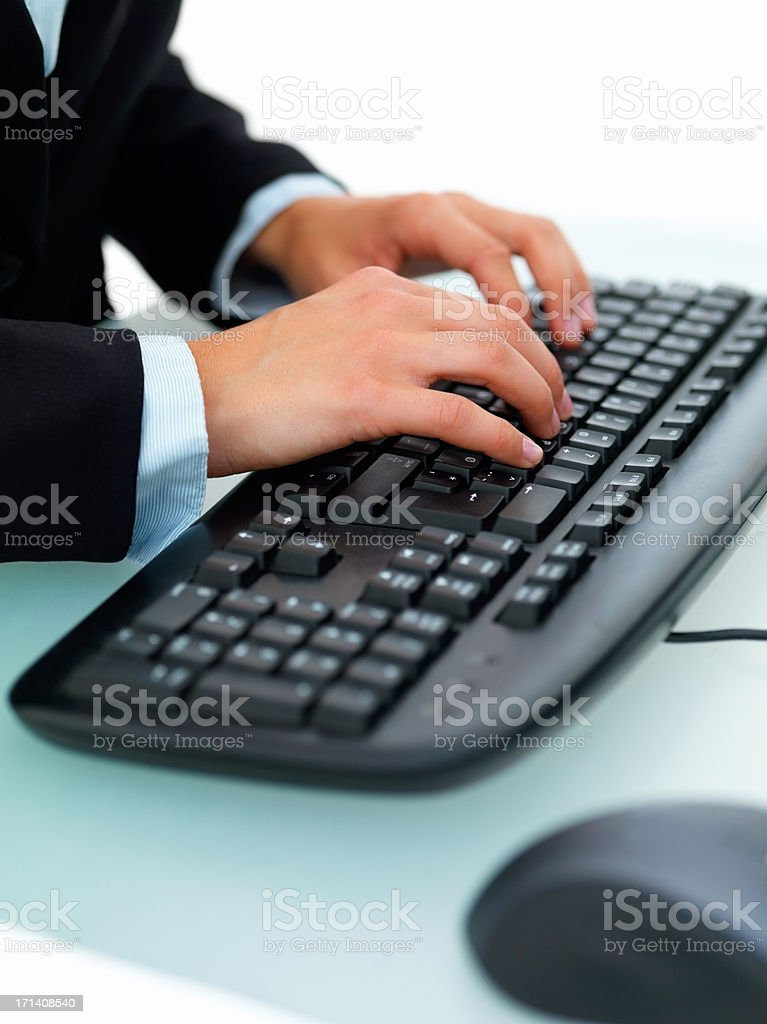 Closeup of a female's hand typing on a computer keyboard royalty-free stock photo