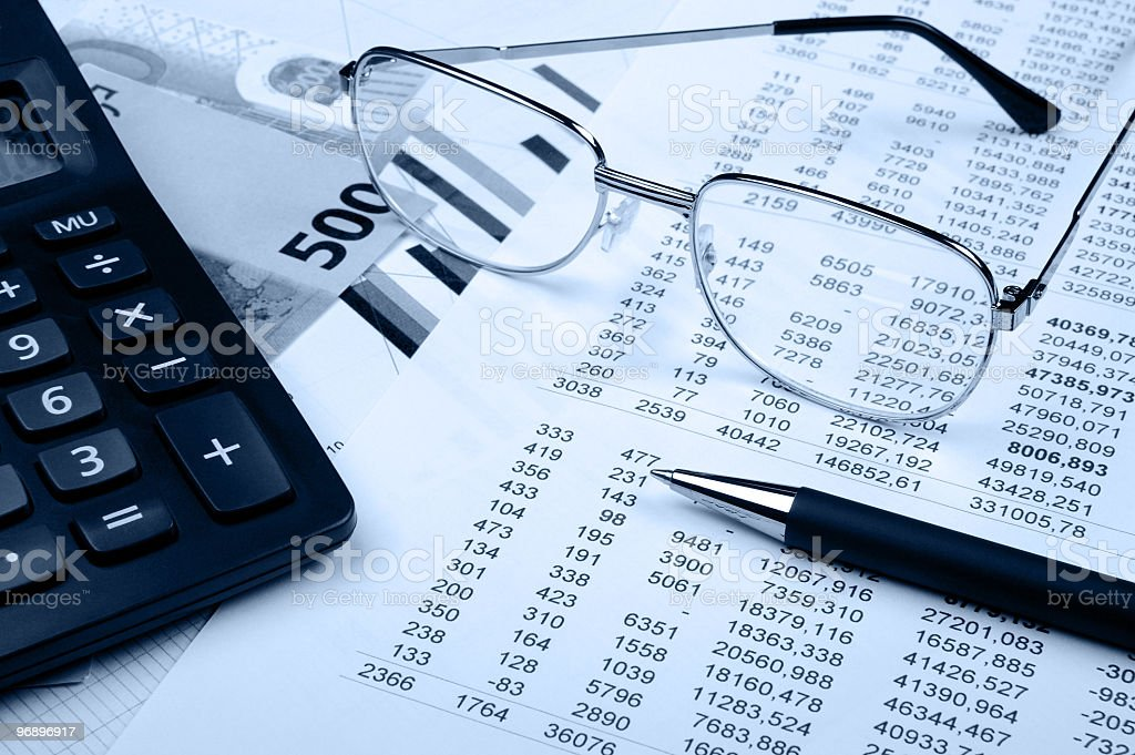 Close-up of a financial report with sunglasses and pen on it royalty-free stock photo