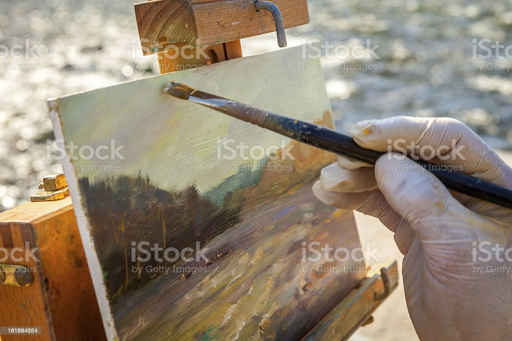Closeup of a Fine Artist Painting A Landscape on Easel stock photo