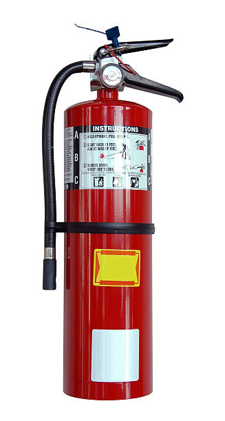 A close-up of a fire extinguisher on a white background stock photo