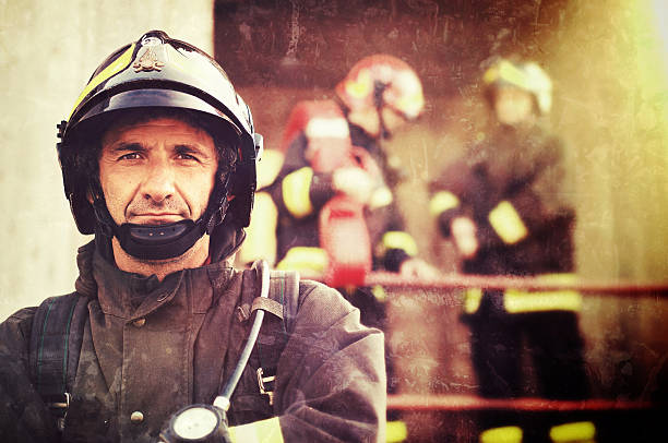 close-up of a firefighter - firefighter stock photos and pictures