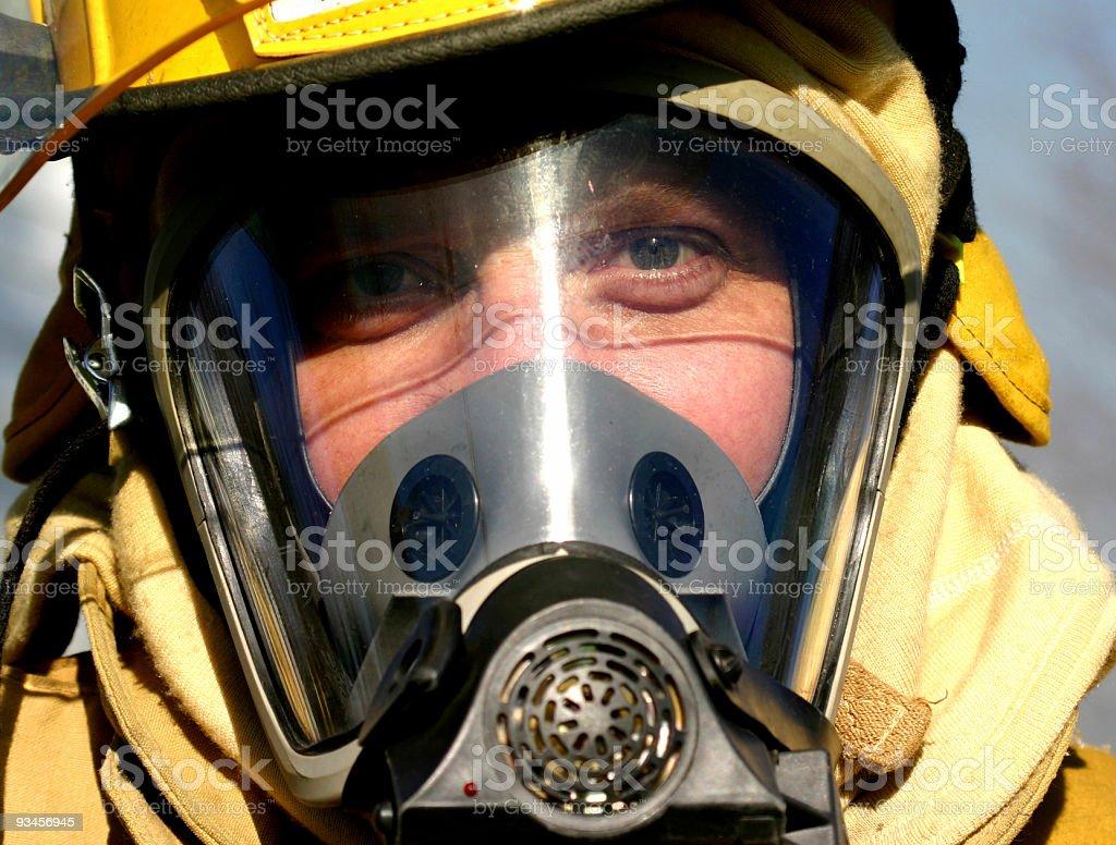 Close-up of a fireman wearing smoke mask royalty-free stock photo