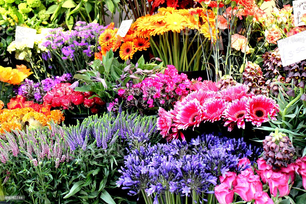 Close-up of a flower stall full of colorful flowers stock photo