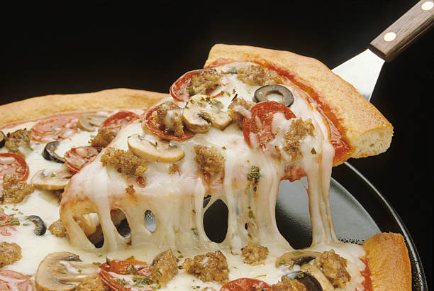 Close-up of a fresh pizza being served stock photo