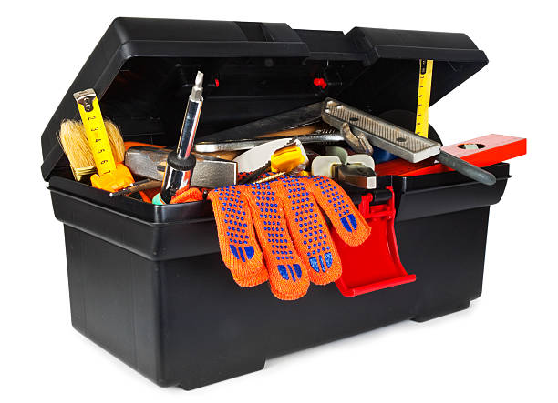 A close-up of a full black toolbox on a white background stock photo
