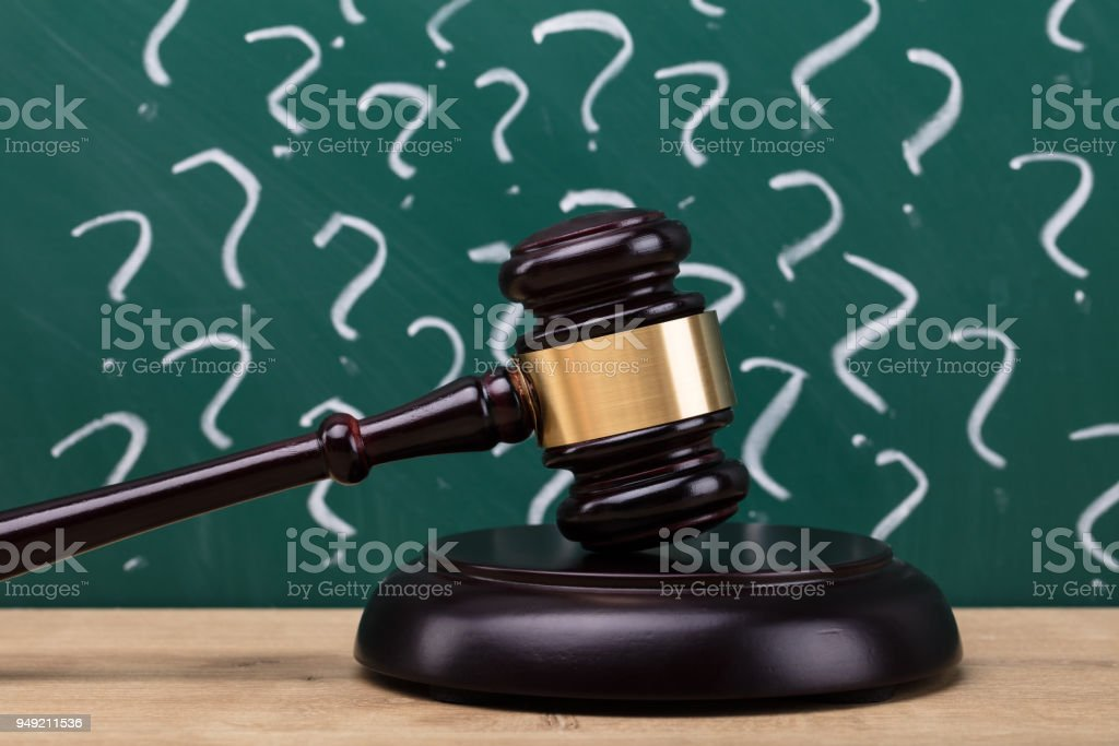 Close-up Of A Gavel On Wooden Desk stock photo