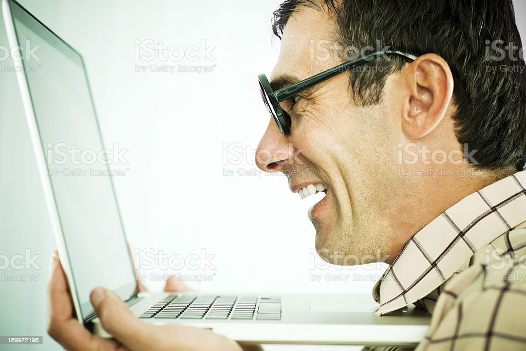 Close-up of a geek looking at his laptop. royalty-free stock photo
