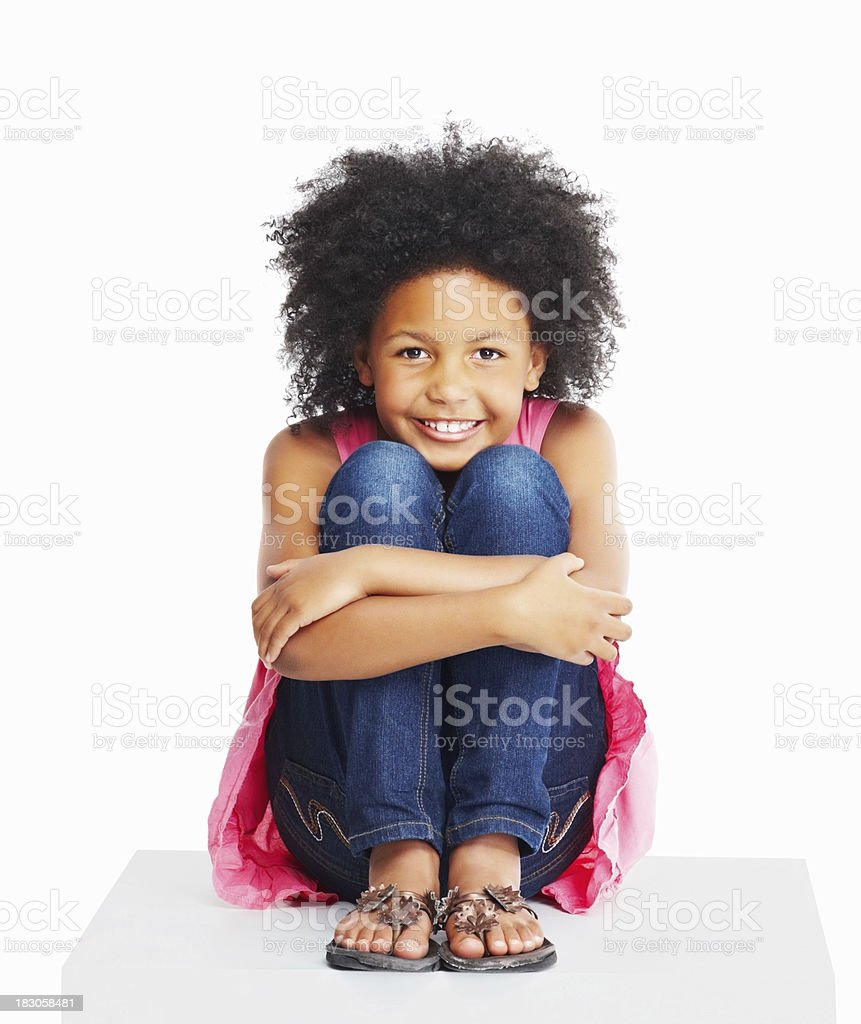 Closeup Of A Girl Child Hugging Knees Sitting Against White Stock