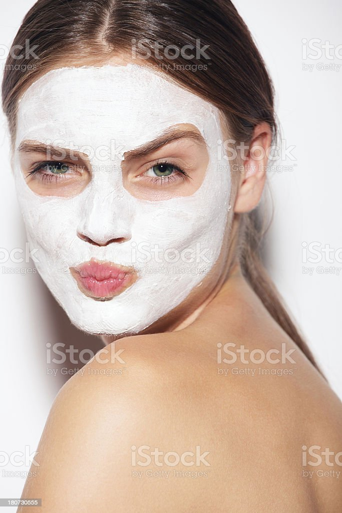 closeup of a girl wearing facial clay mask stock photo